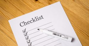 A list with check marks, titled Checklist.