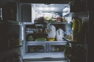 An open refrigerator full of food.
