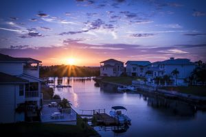Houses by the water in the sunset.