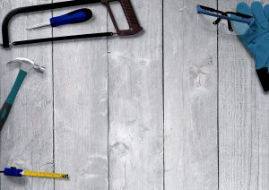 Tools on a hardwood floor.